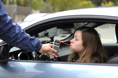 Woman Taking Breathalyzer Test